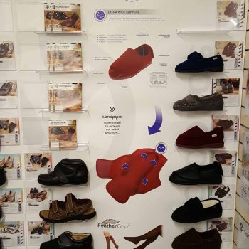 wall of Sandpiper shoes in showroom