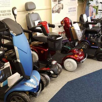 range of mobility scooters lined up in showroom